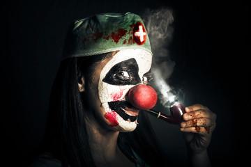 Fine art horror portrait. Smoking surgeon clown