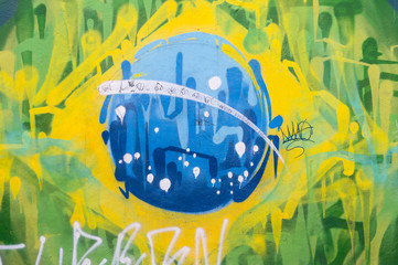 Abstract Brazilian flag made from brightly colored graffiti brushstrokes