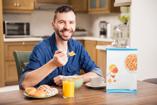 Happy guy eating cereal