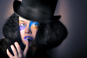 Beautiful high fashion woman in creative makeup