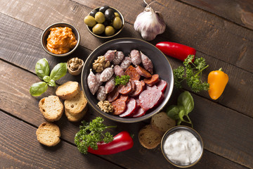 appetizer with sausages,cheese,olive and nuts