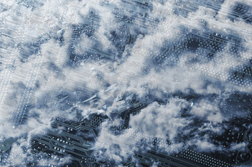 computers circuit-board with large cloudscape hovering above