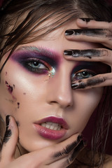 Beauty portrait of a young girl with fashion creative make-up