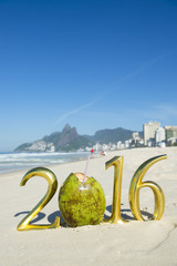 Gold 2016 message with green coco gelado drinking coconut on the beach in Rio de Janeiro, Brazil