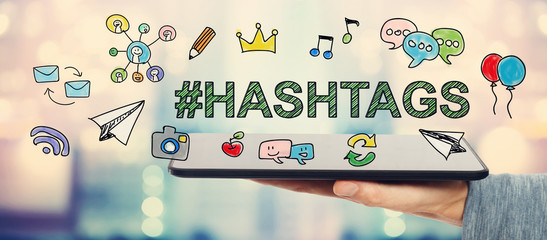 Hashtags concept with man holding a tablet