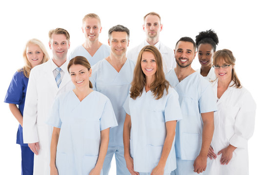 Happy Medical Team Standing Against White Background