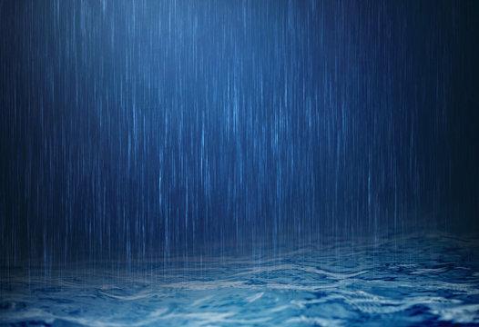 rain water drop falling to the surface water in rainy season