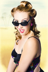 Surprised pinup girl on tropical beach background