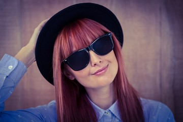 Smiling hipster woman posing face to the camera