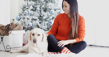 Young woman and her dog celebrating Christmas
