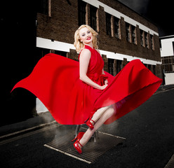 Blond Marilyn Monroe pinup girl in retro dress