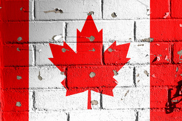 Canadian flag on peeling wall.