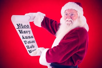 Composite image of father christmas holds a list