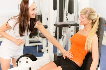 Two beautiful sportwomen make exercise