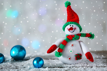 Cute snowman on Christmas background