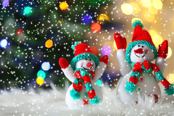 Cute snowmans on Christmas background