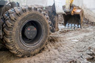Wheel loader Excavator works in construction site