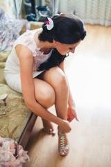 makeup artist preparing beautiful luxury stylish brunette bride hair for special wedding day