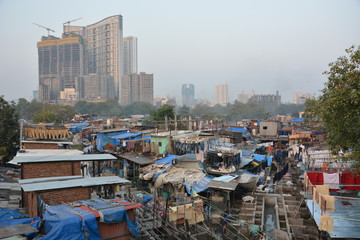 Mumbai, India - October 19, 2015 - Muslim washing spot Dhobi Ghat in front of Mumbai skyline.