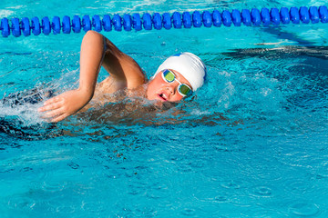 Action shot of teen freestyle swimmer.