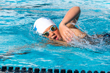 Close up action shot of teen swimmer.