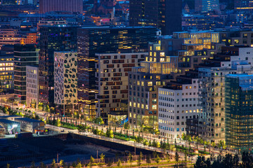 Oslo, Norway - July 15, 2015: Night view of illuminated street in the Oslo business center. Modern architecture in Norway