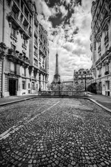 Eiffel Tower seen from the street in Paris, France. Black and white