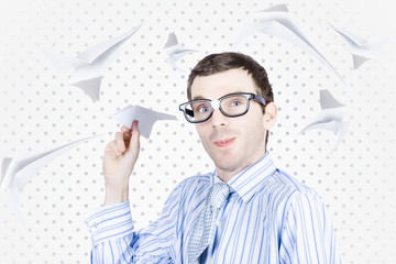 Smart travelling business man throwing paper plane