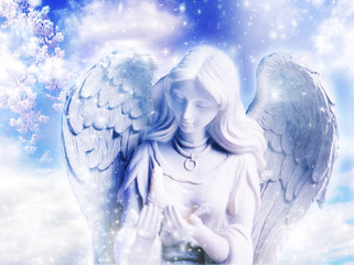 Wall Mural - a statue of angel over a spring background