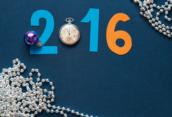 New Year background with date 2016, watches and festival beads