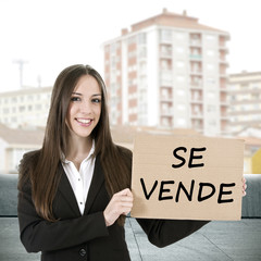 realtor woman with sign and houses