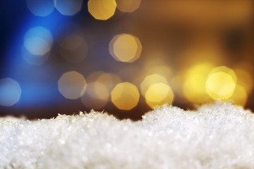 snow with lights in background