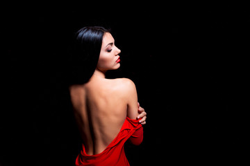 Elegant woman in red dress getting stripped