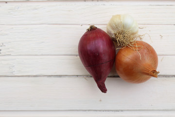 Onions bulb on white wooden table