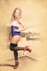 Happy navy pinup girl in retro fashion accessories