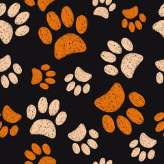 Seamless pattern with doodle paws. Vector illustration of cats footprints on dark background.