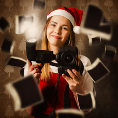 Camera holding santa helper taking christmas photo