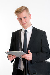 businessman in black suit with tablet PC