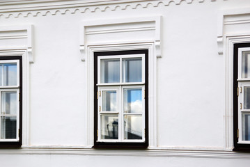 Window on the white wall of the house