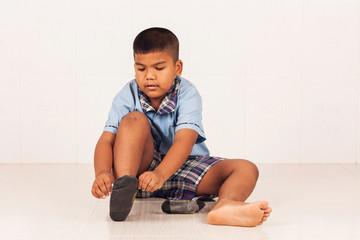 cute little school boy wear socks