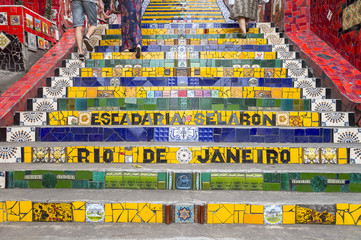 Tourists visit the colorful mosaic tiles at the Selaron Steps in Lapa, Rio de Janeiro, Brazil