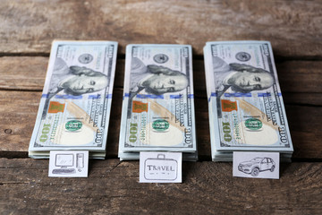 Packs of American dollars, on wooden background. Saving concept