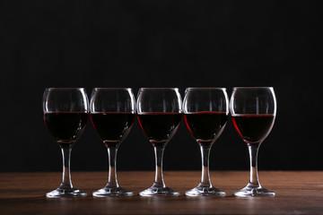 Half full wine glasses on a table