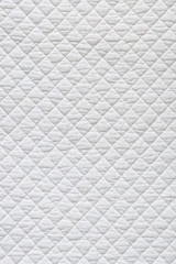 Closeup of white quilted fabric