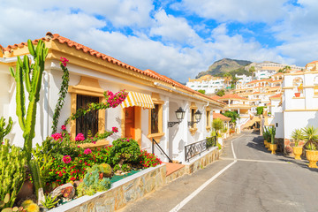 Wall Mural - Street with typical Canary style holiday apartments in Costa Adeje, Tenerife, Canary Islands, Spain