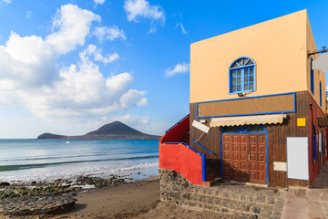 Colourful house on beautiful El Medano beach at sunrise time, Tenerife, Canary Islands, Spain