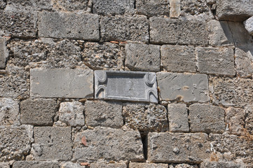 a plaque in the wall of Roman baths