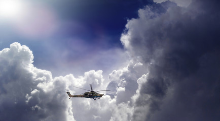 Helicopter against the beautiful clouds