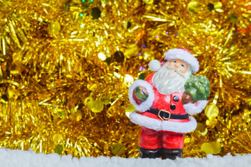 Santa Claus and golden ribbons on background with copy space