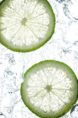 fresh lime slices in soda